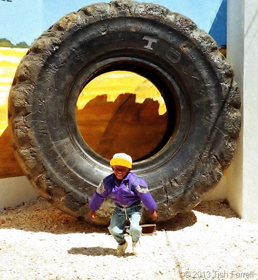 Lusaka agricultural show - Boy and copper belt truck tyre